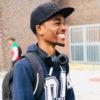 man-wears-black-cap-blue-hoodie-and-backpack-at-the-school-2826131_02